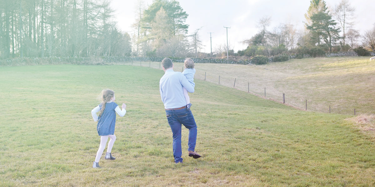 family outdoors in the country