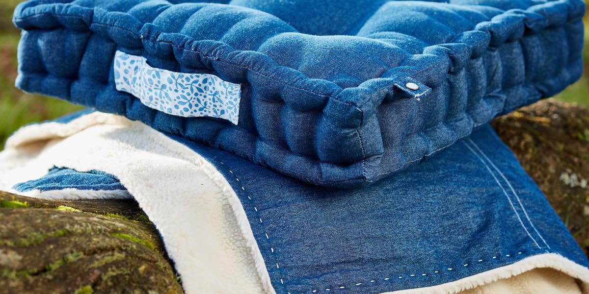 Denim seat pads cushions and denim fleece blanket. Denim home interiors trend