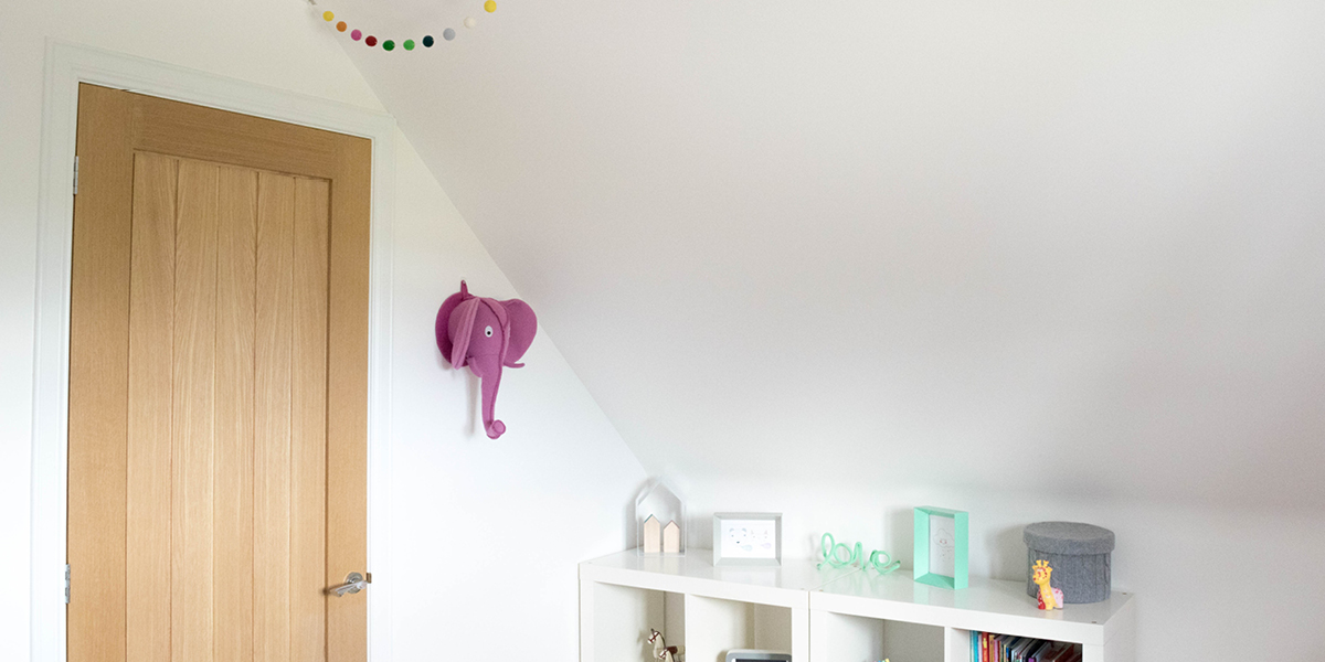Little girls bedroom with pom pom garland